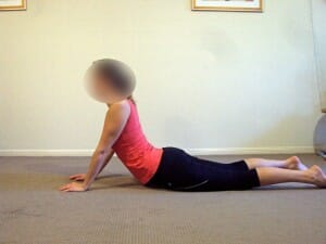 Prone extensions in lying McKenzie exercise for disc low back pain physiotherapy